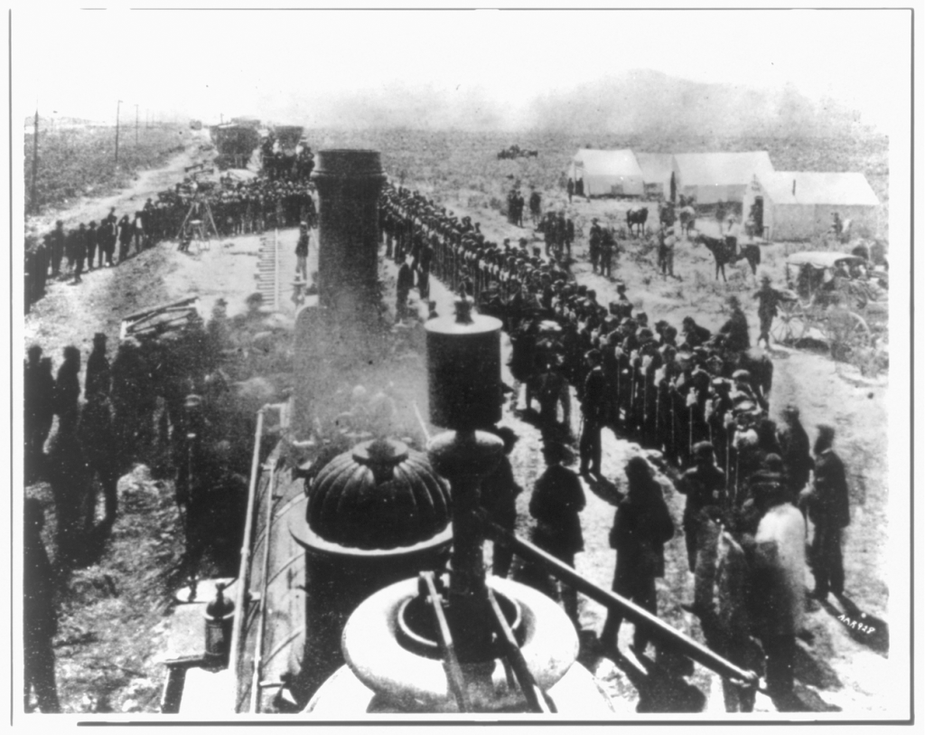"""Ceremony at """"Wedding of the Rails,"""" May 10, 1869 at Promontory Point, Utah – credit Library of Congress"""